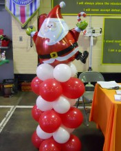 Santa Claus is coming to down on top of one of our unique balloon columns.