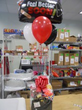 "This ""feel better soon"" balloon bouquet and basket make a nice gift to someone recovering from any sickness.  Pack the basket with lots of goodies so that the patient can just relax."