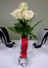 Flowers in high heel vase