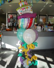 "Squiggles, balloons, and cake OH MY!! This ""rocking"" balloon bouquet will rock your world."