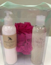 Clear box with ribbon filled with spa products.