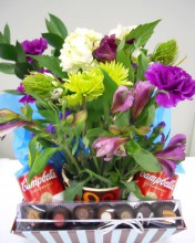 A perfect mixture of flowers, Campbell's soup, and chocolate. Perfect for that friend or coworker has been feeling sick and needs a pick me up.