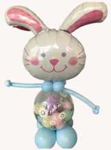 Easter bunny balloon sculpture with candy, eggs and plush bunny inside the balloon body.
