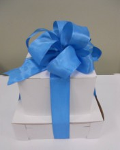 Choose from our white, black, or pink boxes.