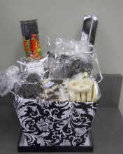 Got a chocolate lover you need a gift for? This basket is PERFECT!! It has fudge, chocolate covered pretzels, gourmet truffles, almond bark, and much much more!! Just to add a special kick, we include a tube of jelly beans! Yum!!